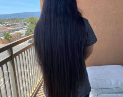 28 inches of black shiny lustrous and voluminous hair