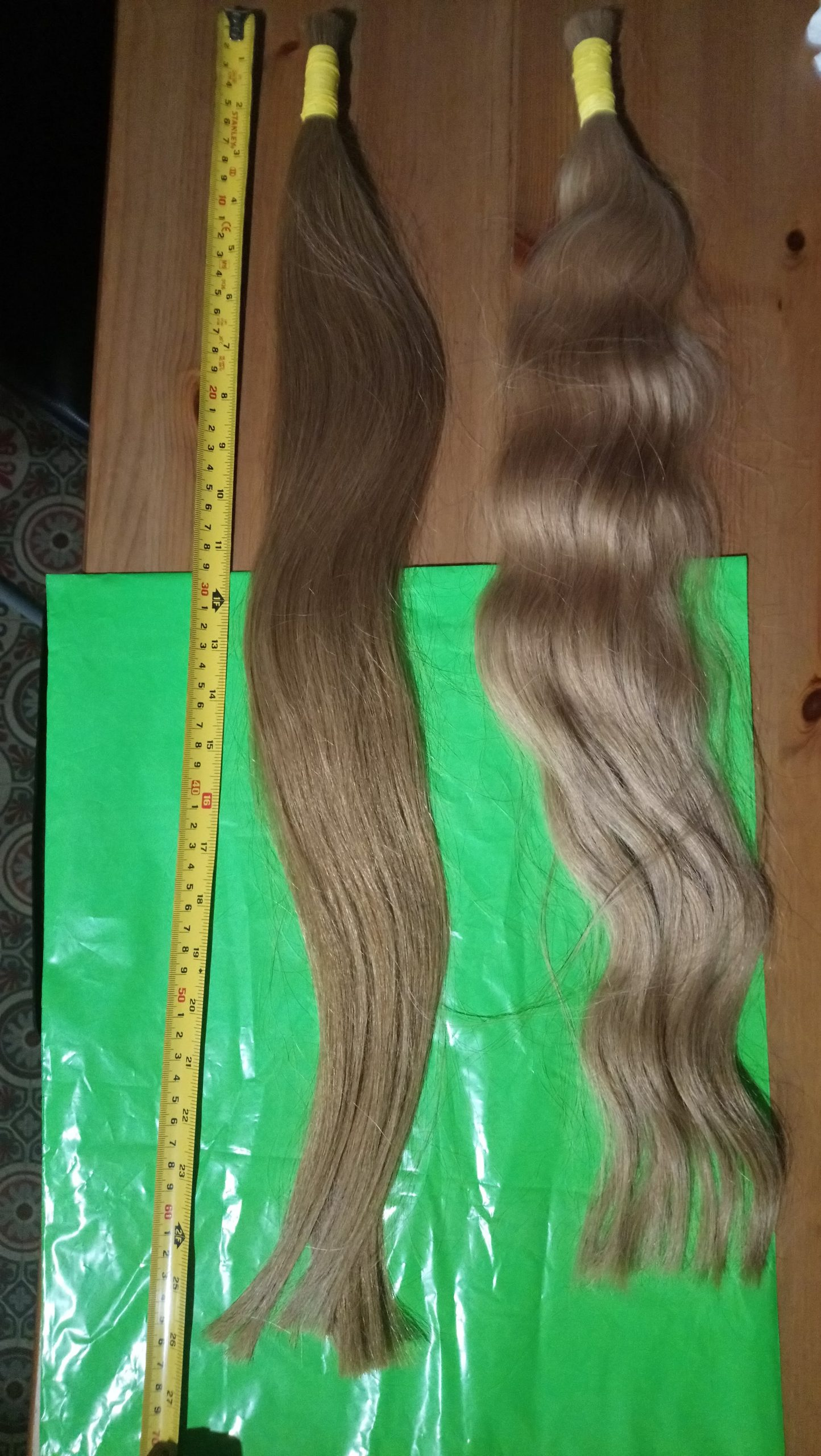 Quality Virgin Blonde two tails 2.5 inches thick and 26 inches long straight with wavy ends